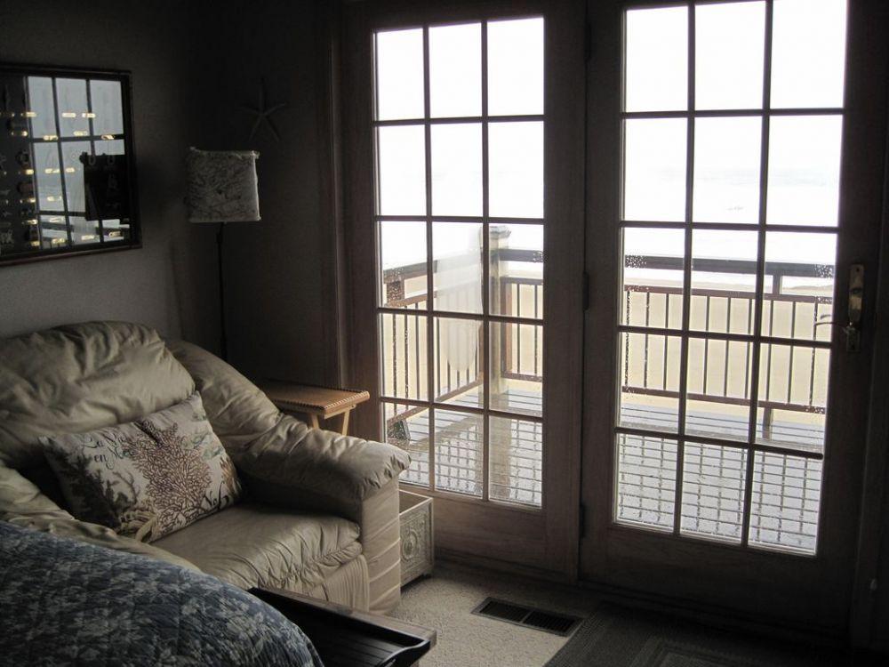 Oceanfront bedroom with French door to deck
