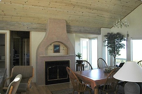 Great Room/Dinning: Gas fireplace, table sits 8, more magnificent views