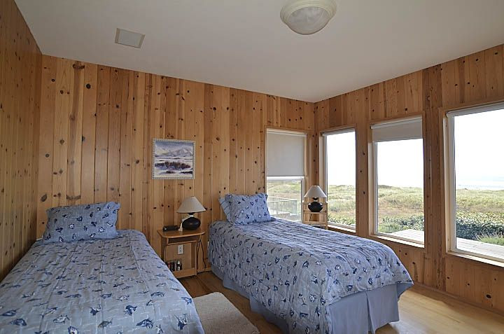 Twin Bedroom has access to its own bathroom + panoramic views of ocean and beach