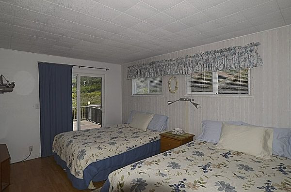 Second bedroom features two Queen sized beds and access to the hot tub deck