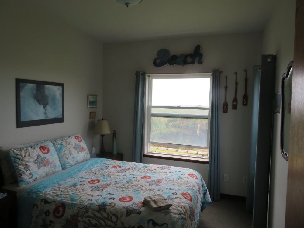 Bedroom with Queen Bed and Oceanfront View