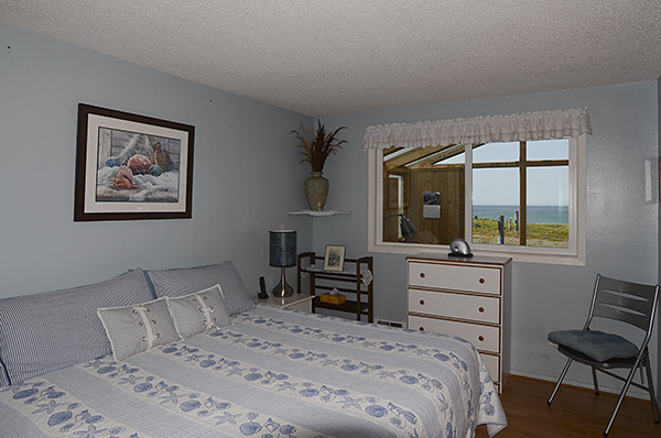 Master bedroom with King sized bed facing the ocean