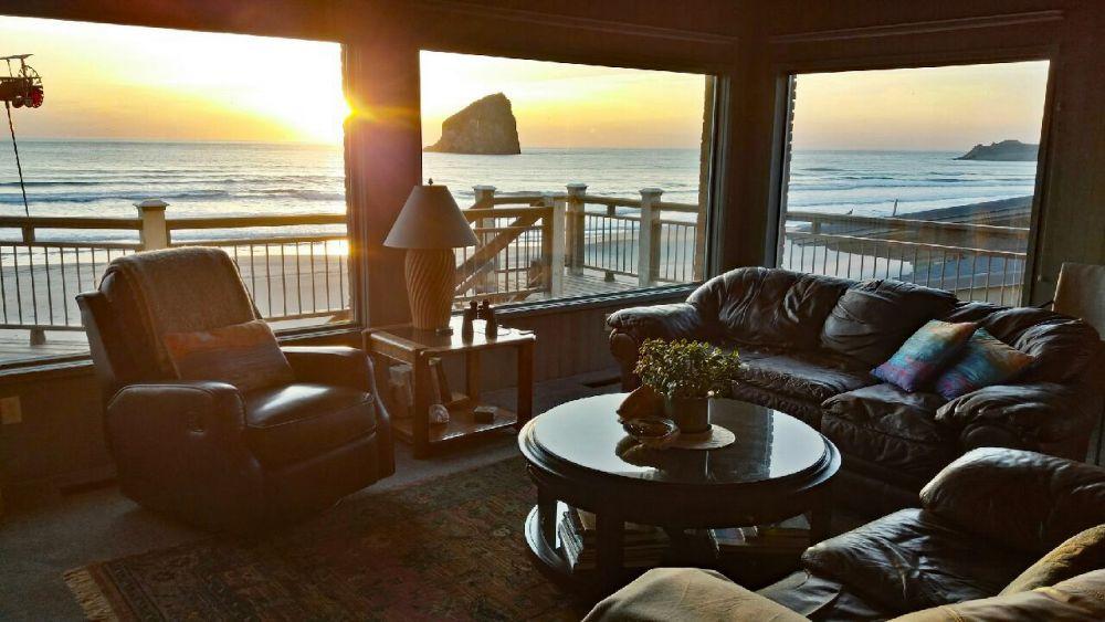 Living room at sunset with view of Chief Kiwanda Rock and Cape Kiwanda