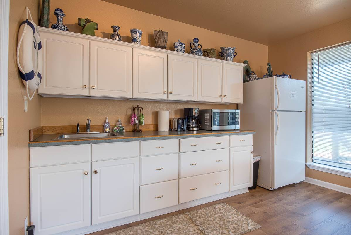 Lowest level has its own Kitchenette with Refrigerator, microwave, coffee maker, sink and more.