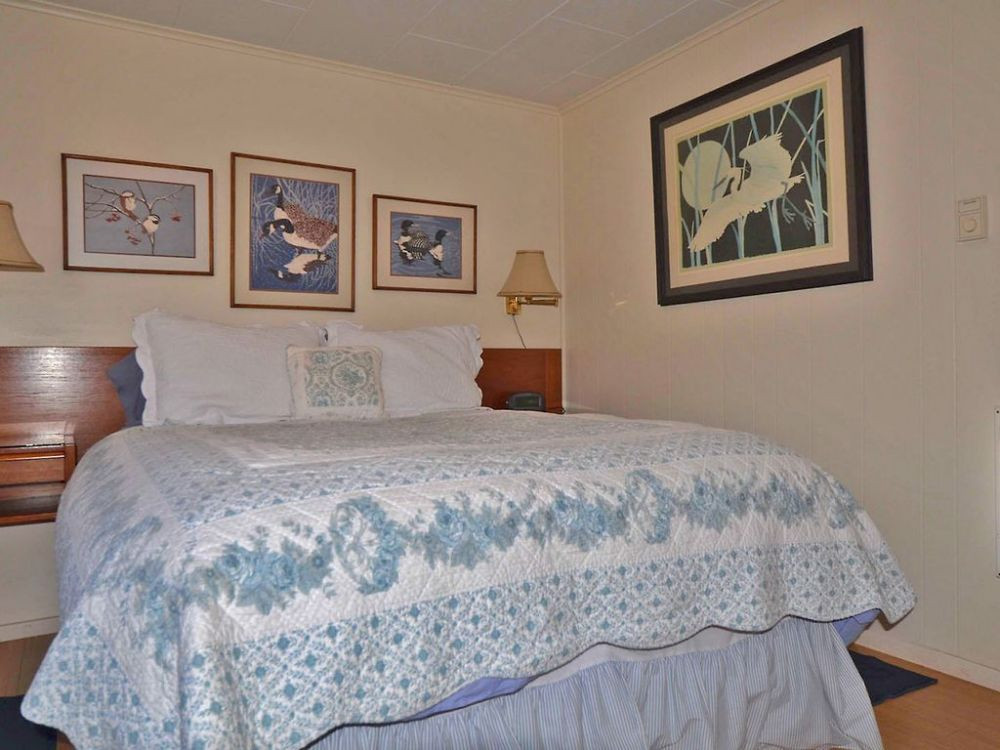 Lovely Queen bedroom with goose down comforter & a hand made quilt