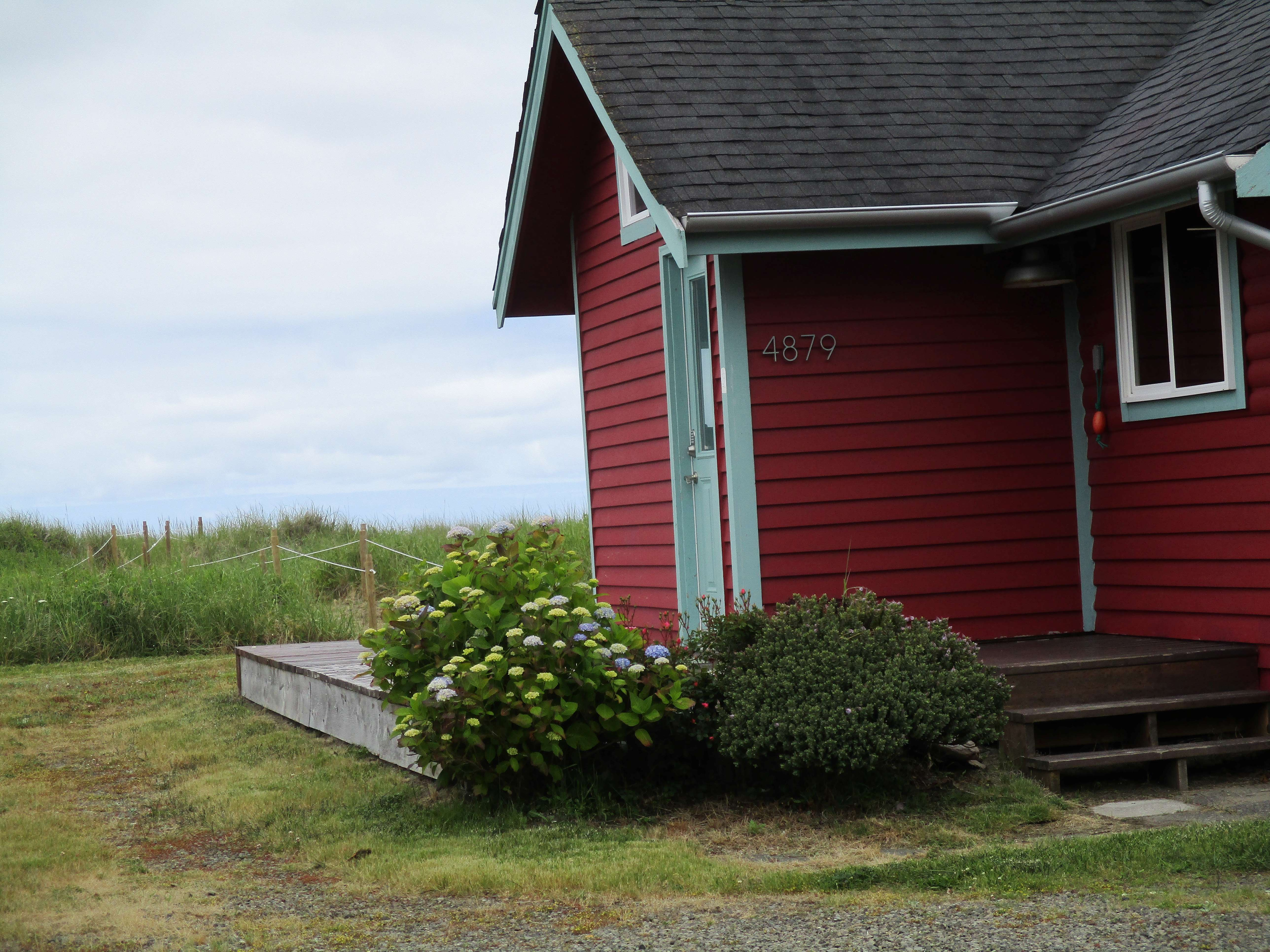 View from road past house to the ocean
