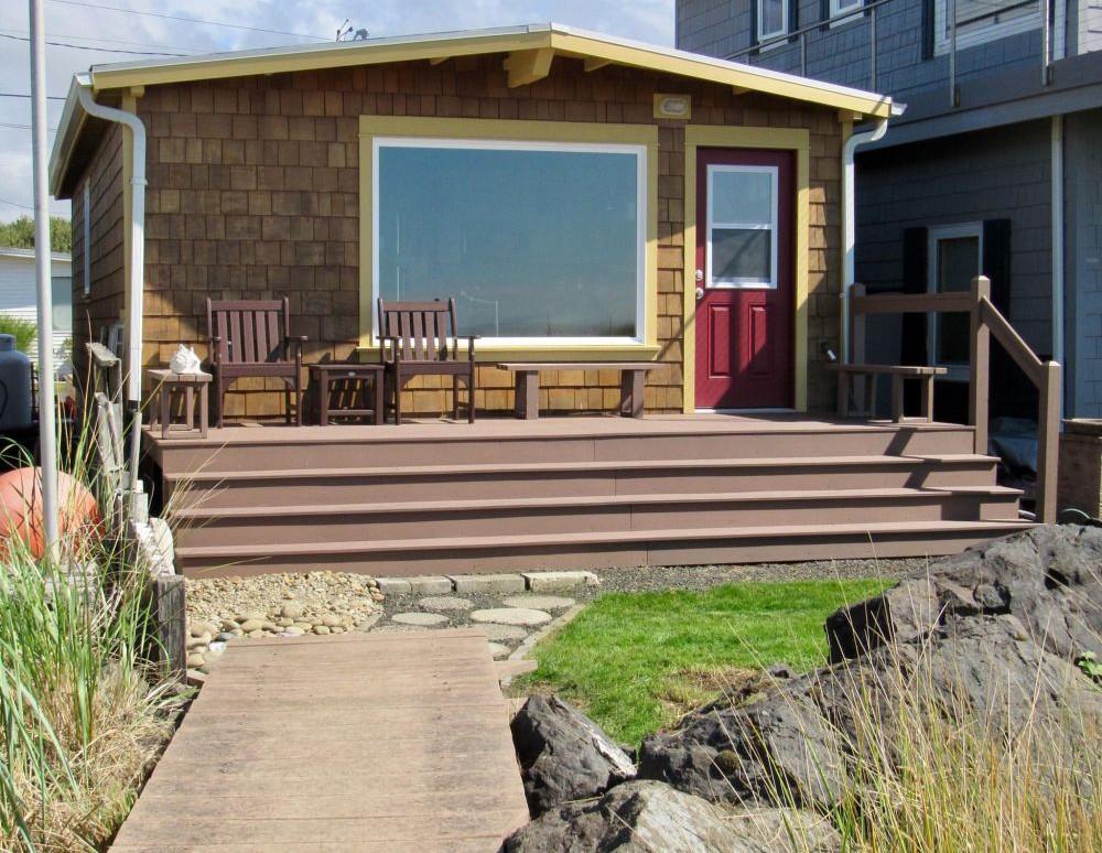 Beach side of beach house with deck